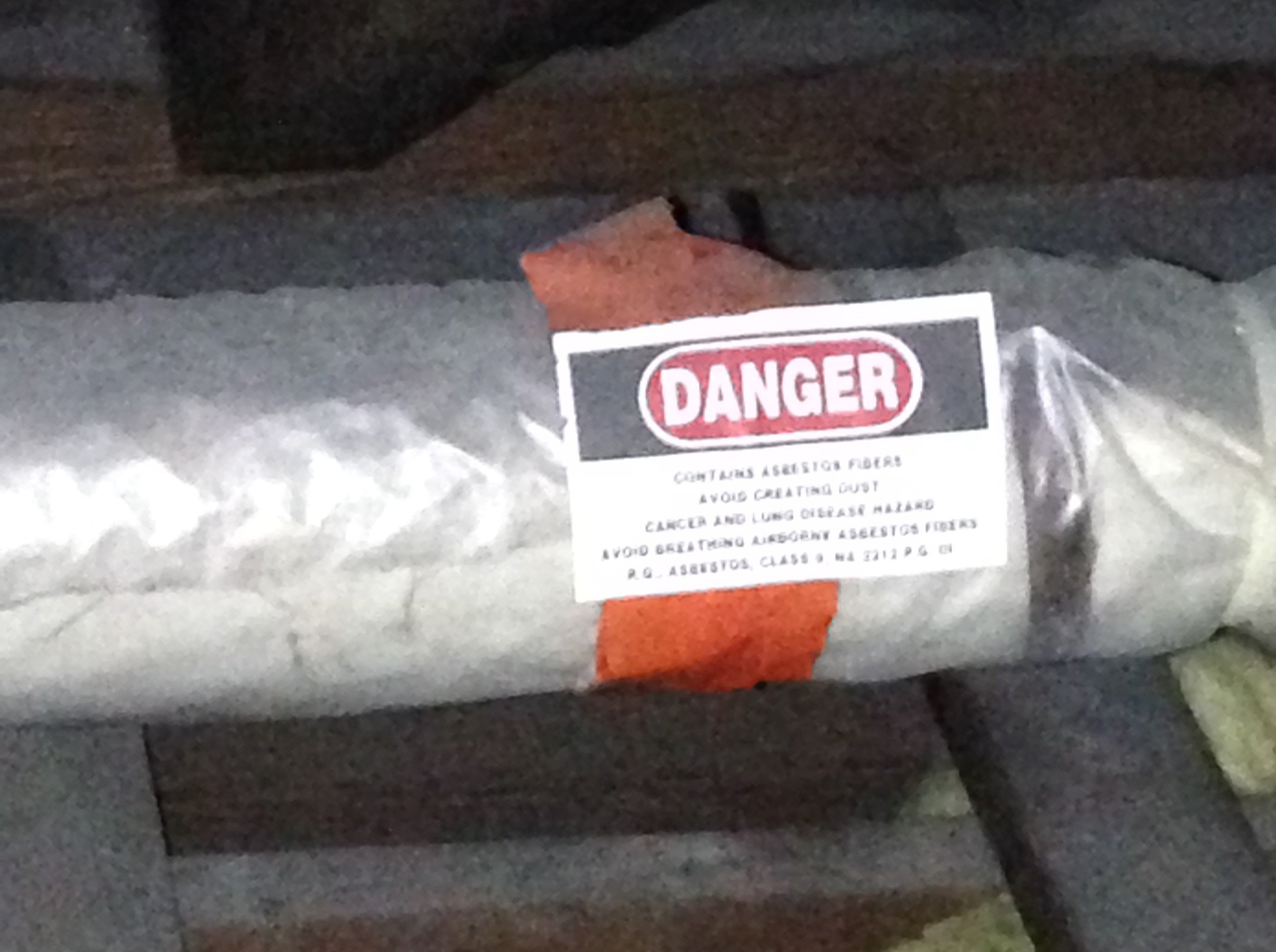 Pipe insulated with Asbestos-Containing Material